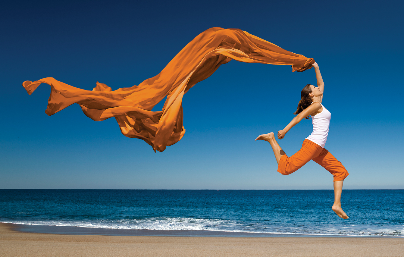 Woman jumping with scarf